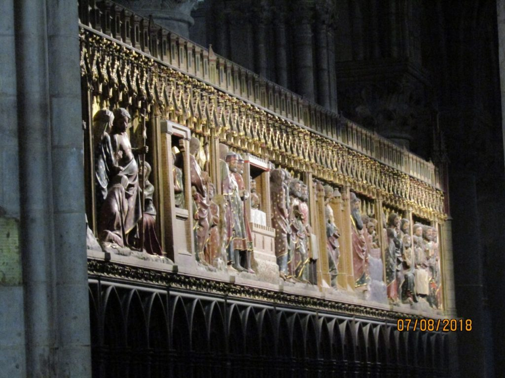 Medieval wood sculpture on the chancel screen in Notre Dame de Paris depicting biblical scenes - photo by Lysandra Furstenberg