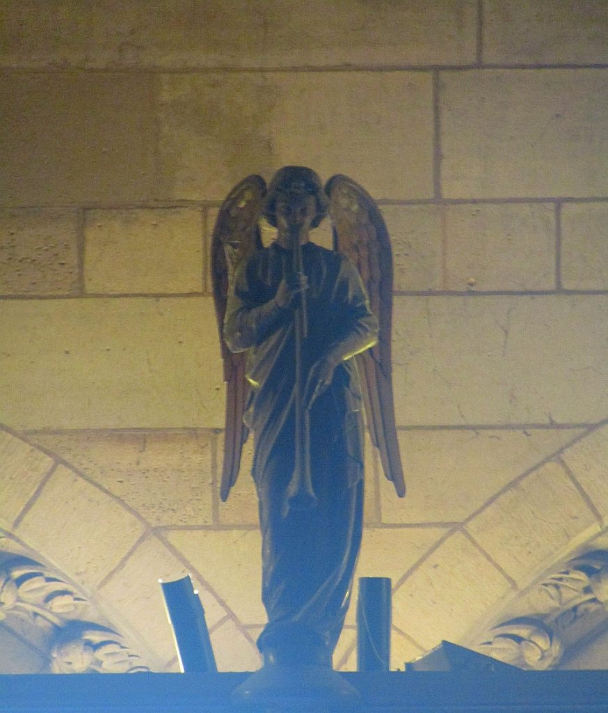 Notre Dame Cathedral - Angel statue standing above the main entrance - photo by Lysandra Furstenberg