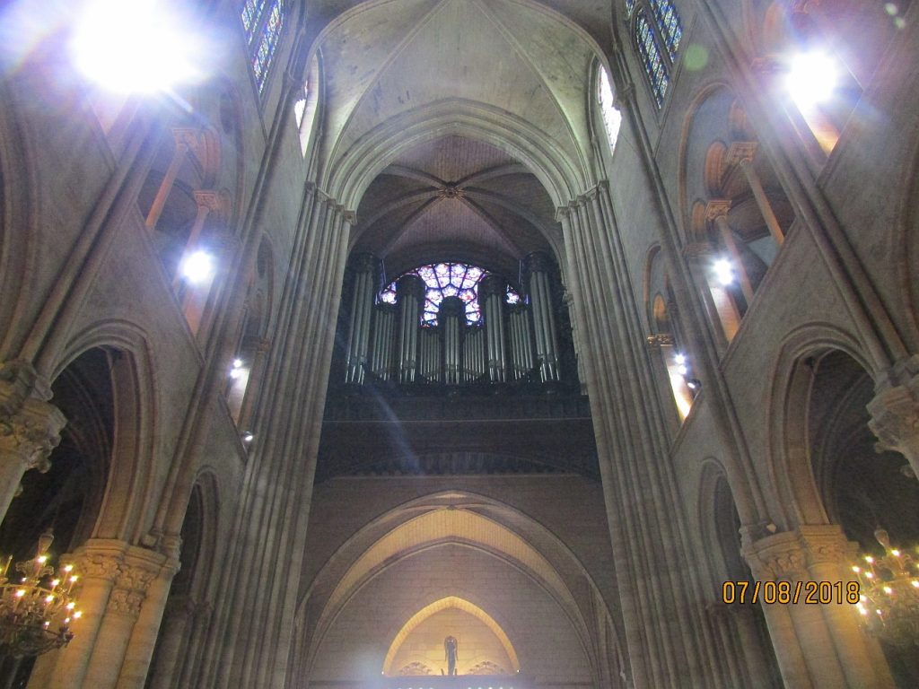 Notre Dame Cathedral - view of organ, West rose window and Angel statue standing above the main entrance - photo by Lysandra Furstenberg