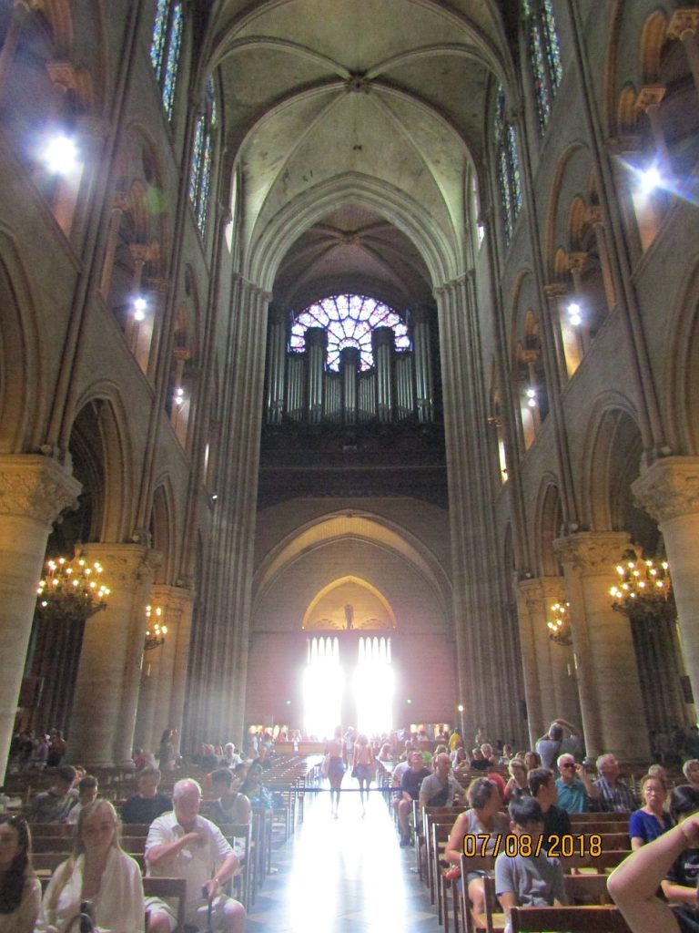 Notre Dame Cathedral - view along the nave towards the main entrance and vaulted ceiling - photo by Lysandra Furstenberg