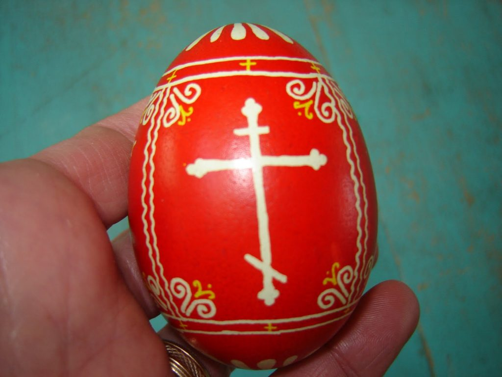 Orthodox cross on a red Easter egg