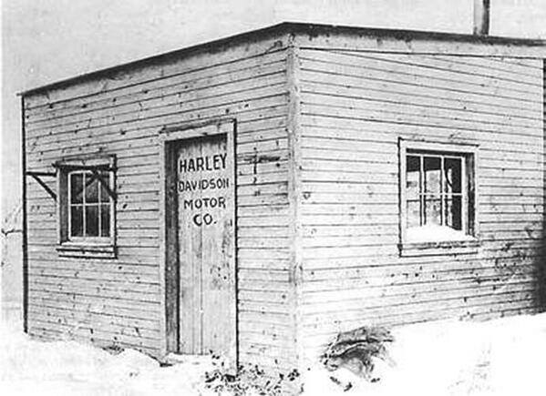 The first Harley-Davidson factory, a tiny wooden shed in the Davidson family backyard in Milwaukee. 1903.