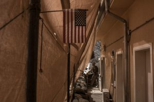 A U.S. Marine looks out from his post in September at Bost airfield in Helmand province. Andrew Renneisen-Getty Images