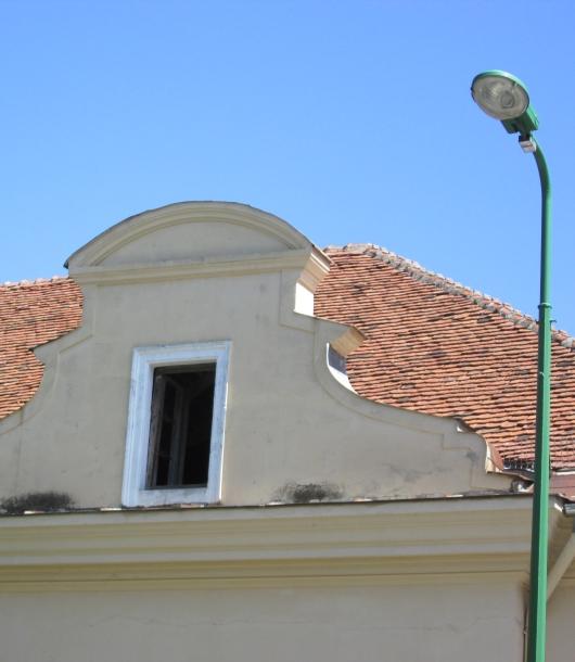 A modern street light near an old attic window in Brasov, Romania. Image by @PatFurstenberg