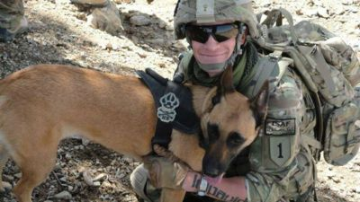 Photo of U.S. Army veteran Joe Steenbeke with military dog Tess in Afghanistan Credit Reunite Joe and Tess, Facebook
