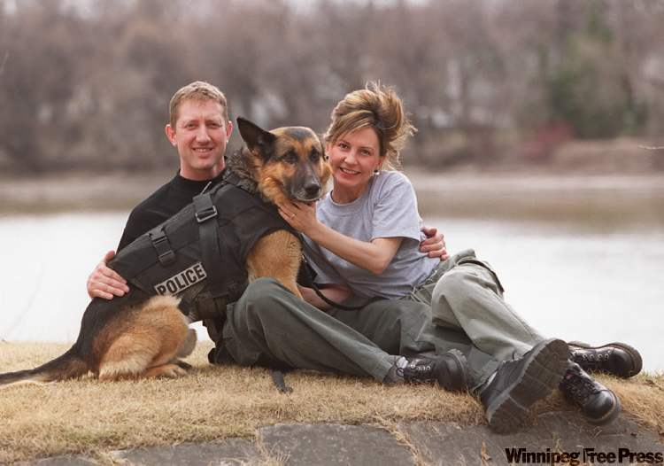 Olaf with his human handler and friend, Jim Slater, who fashioned the first dog bullet-proof vest. Source Winnipeg Free Press