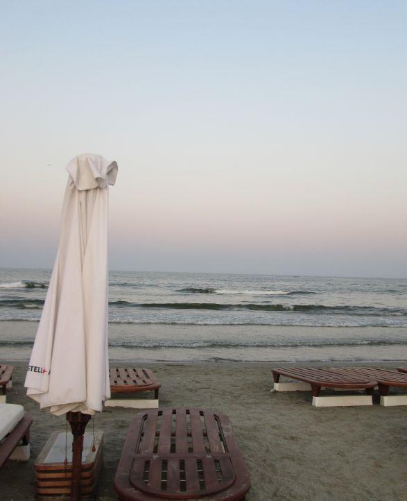 white beach umbrella by the sea @PatFurstenberg