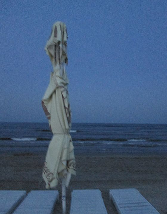 umbrella and windy evening on the beach @PatFurstenberg