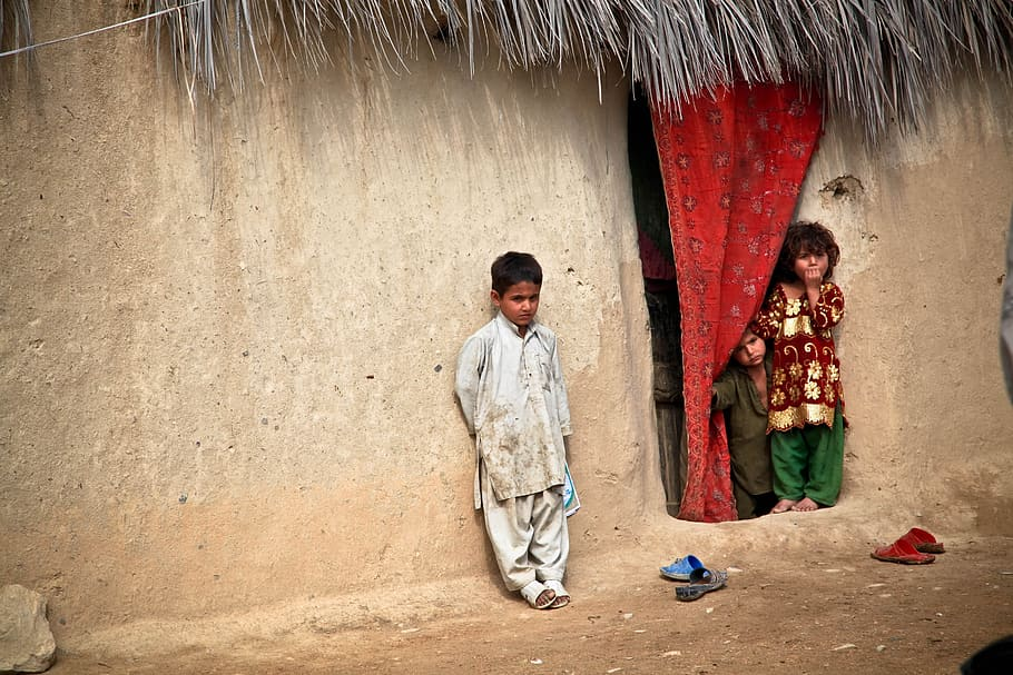 boy and girl. Silent Heroes Afghan village