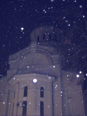 white flakes against a Christian Orthodox church