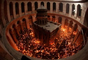The Holy Fire at the Rotunda of the Cathedral of the Holy Sepulchre in Jerusalem on Holy Saturday.