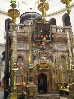 The Tomb of Christ, within the Cathedral of the Holy Sepulchre, from which the Patriarch of Jerusalem emerges with the Holy Fire. The Holy Fire of Easter
