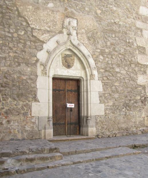 An Ancient Door Corvin Castle, Castelul Hunedoara, Romania, coat of arms Iancu de Hunedoara, Raven with a ring