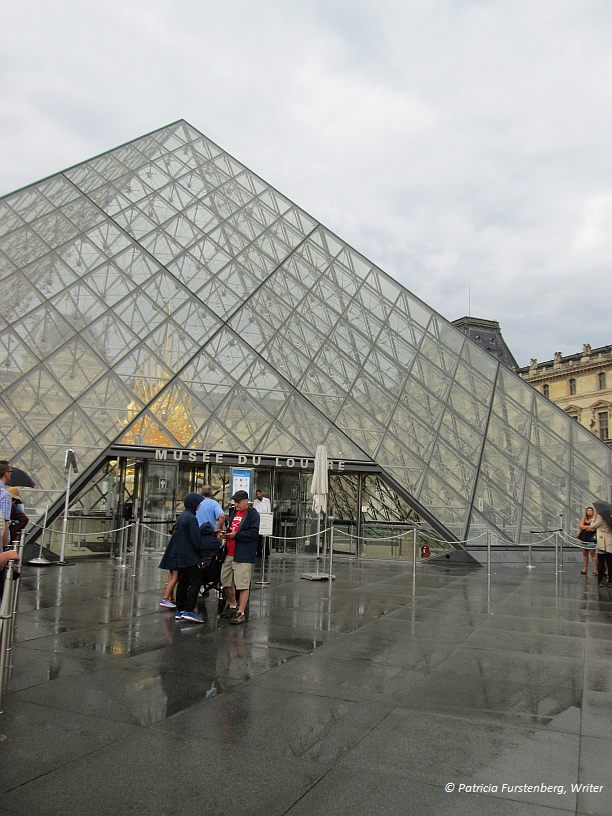 Doors from Bucharest or Paris, Guess! Lourve Museum Glass Pyramid Entrance