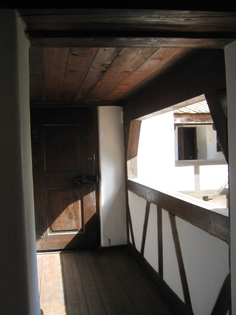 Sunny balcony at Bran Castle, wooden finishing offering a soft finish to this old military stronghold