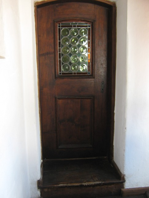 Bran Castle, glass and wooden door. Closed. Saying goodbye.