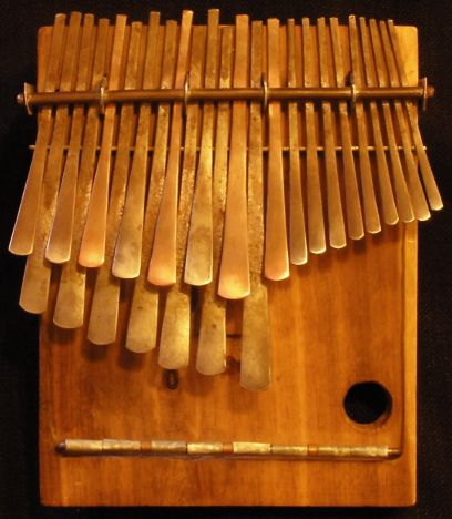 as he ran the rope stretched like the metal tongues of the Mbira, the musical instrument the humans called 'the voice of the ancestors.'