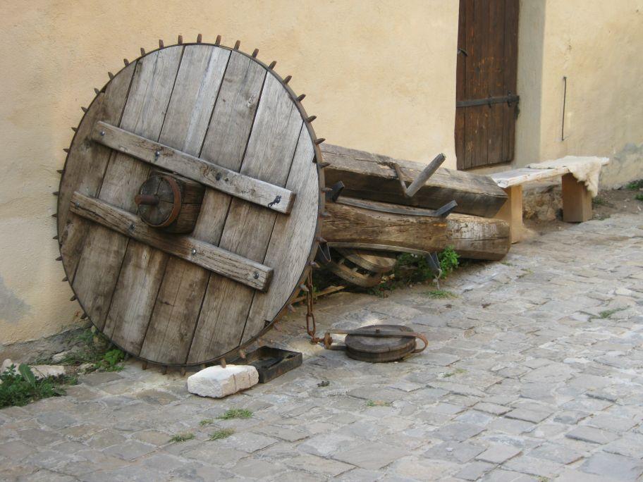Travel to Râșnov Fortress, Romania,  old mill wheel