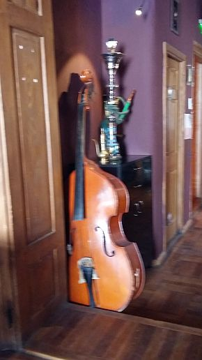 Brasov, where Doors hide Surprises, Bistrot L'Etage, a cello as decor