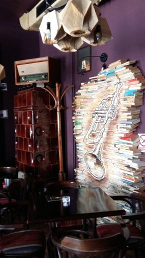 Brasov, where Doors hide Surprises, Bistrot L'Etage, decor - trumpet painted on book spines
