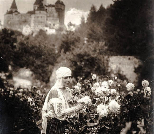 Queen Marie of Romania in her flower garden at Bran Castle, Source National Archives of Romania
