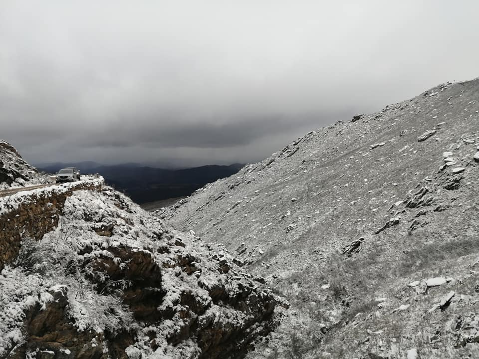 Snow covering the road between Oudtshoorn and Swartberg Pass, South Africa, July 2021