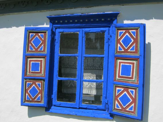 Window shutters painted in dreamy blues adorn an authentic house from 1885 Tulcea, a Romanian county spreading between Danube and the Black Sea.